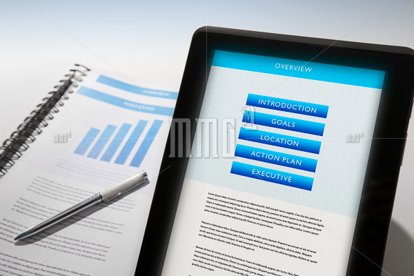 Business Plan displayed on a mobile device and also in binder.