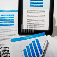 Business strategy documents in print and onscreen via mobile device.
